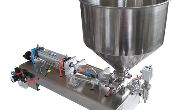 نیم آٹومیٹک پسٹن گلاس جار ہنی فلنگ مشین۔