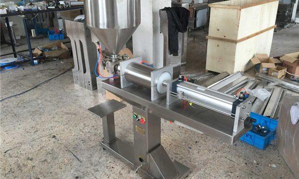 نیم خودکار واحد ہیڈ شہد بھرنے والی مشین۔